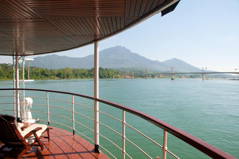 View from cruise ship on the Black River in the Red River Delta, North Vietnam, with Ba Vi National Park in the background.