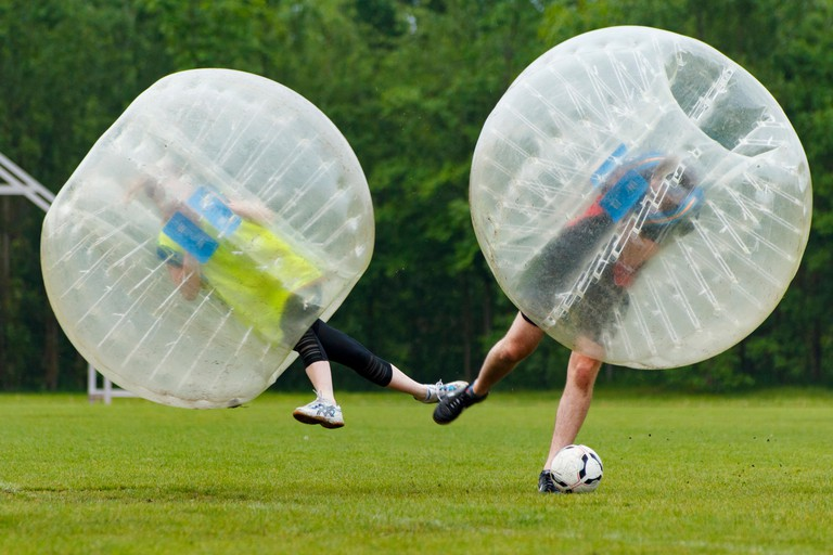 Bubble football funny moment. Concept: Fun, Sport, Flying.