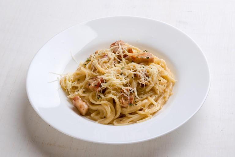 GNRHMC spaghetti carbonara on white table in white plate