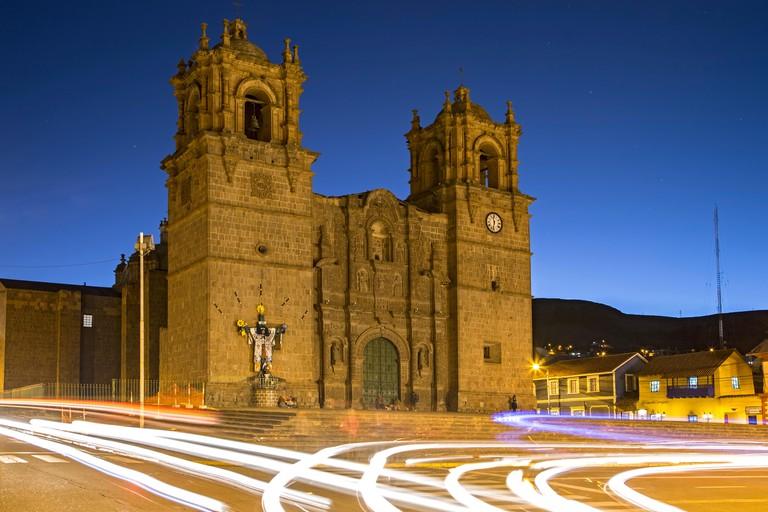 Puno Cathedral and car light streaks, Plaza de Armas, Puno, Peru