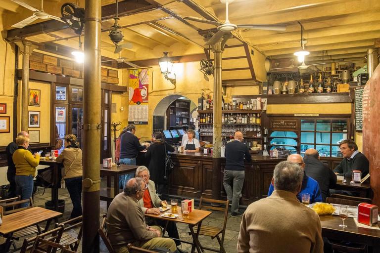 Spain, Andalusia, Seville, Santa Cruz district, Tapas bar Casa Morales with its wine tanks