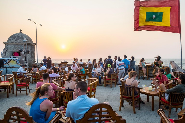 Colombia, Bolivar department, Cartagena, historical center listed as World Heritage by UNESCO, the Cafe del Mar located on the ramparts and favorite p