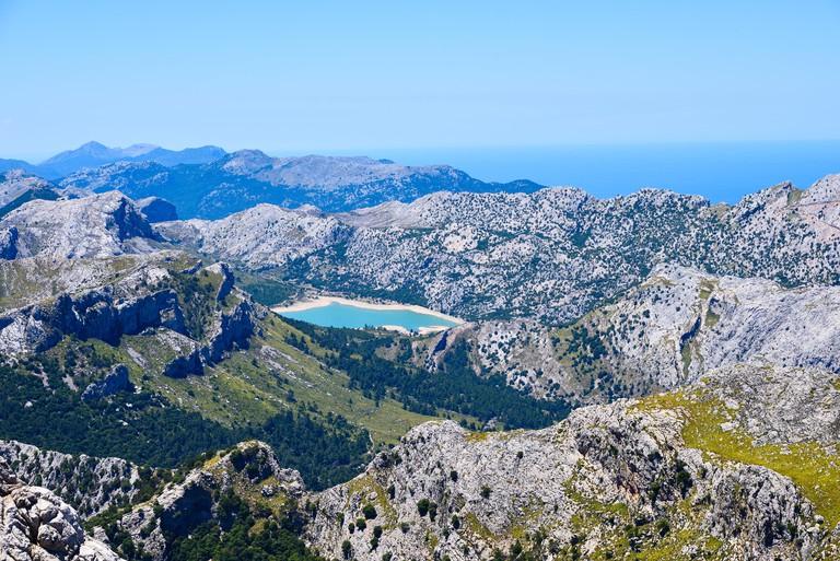 HXEKWH High mountains range Serra de Tramuntana with lake de Cuber viewed from Puig de Massanella on the island of Mallorca in Spain