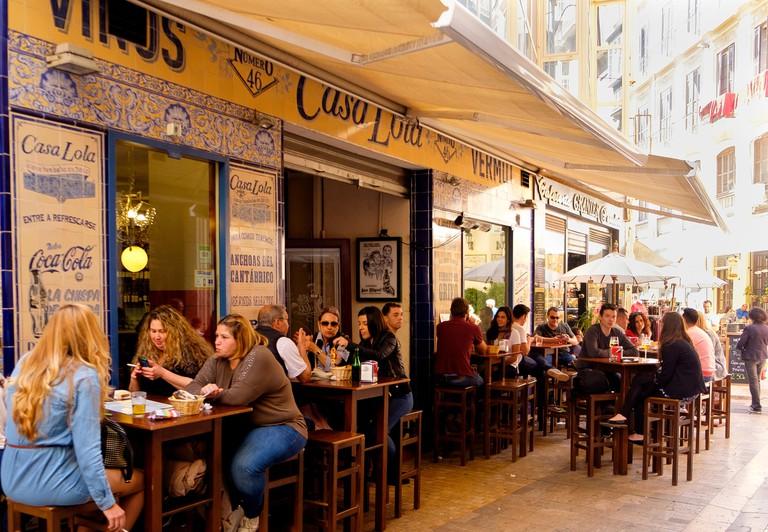 J4DWEC People sitting ouside Casa Lola, a taberna / bar on Calle Granada, Malaga