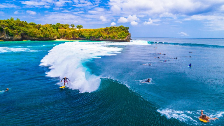 Unidentified surfers at Balangan beach, Bali.