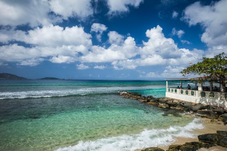 British Virgin Islands, Tortola, Apple Bay, waterfront and Sugar Mill Hotel Restaurant