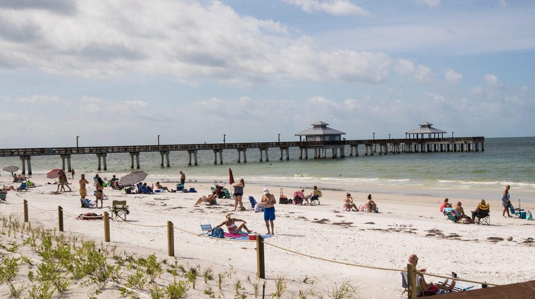 Beach goers are seen at Lynn Hall Park on Fort Myers Beach on Wednesday, April 29, 2020 morning. Lee County opened up the beaches it manages Wednesday to public after they were closed because of the COVID-19 Pandemic. The beach that is managed by the town