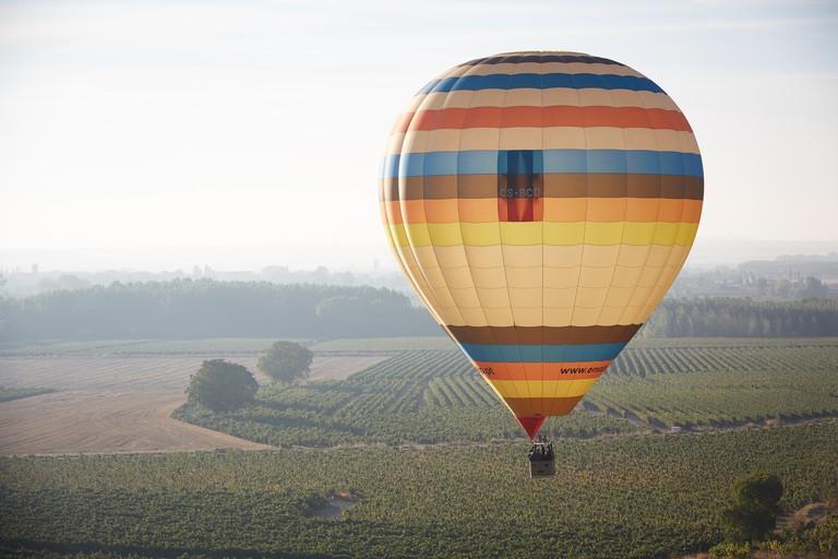 M01P4D Balloon flying over vineyards near Casalarreina, La Rioja, Spain 2016