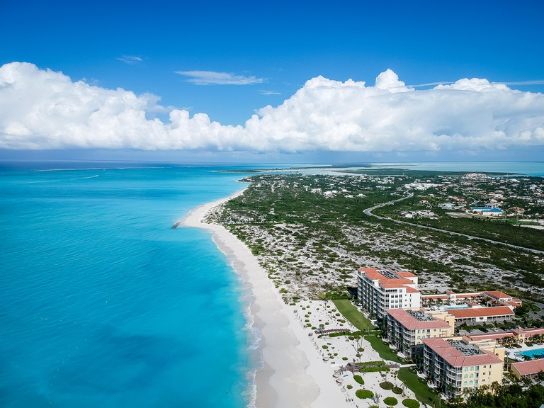Drone photo of Grace Bay, Providenciales, Turks and Caicos. The caribbean blue sea and white sandy beaches can be seen