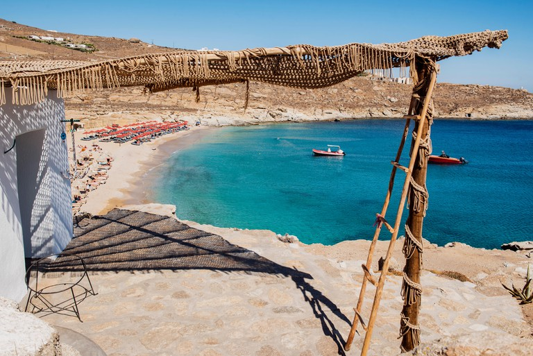 M14RDN Mykonos, Lia beach, Cyclades Islands, Greece. Beautiful panoramic photo taken from above of the clear Lia beach with umbrella and its transparent sea