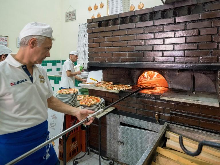 Pizza chef at L'antica Pizzeria da Michele, Naples, Italy.