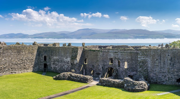 Menai Straits with low mist viewed from inside Beaumaris castle, anglesey north Wales, UK- MMB4D7