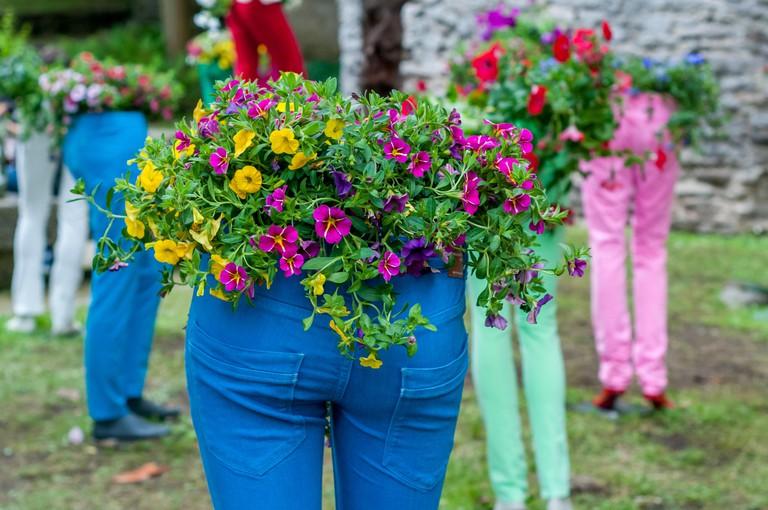 mannequins with flowers on the torso, annual flower festival ?Temps de flors 2018?, Girona, Catalonia, Spain