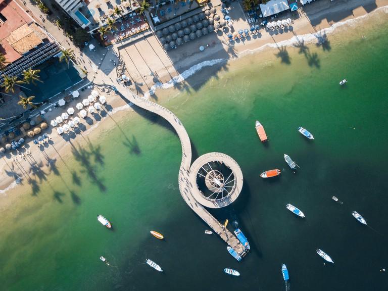 Mexico, Jalisco, Aerial view at Los Muertos beach and pier in Puerto Vallarta