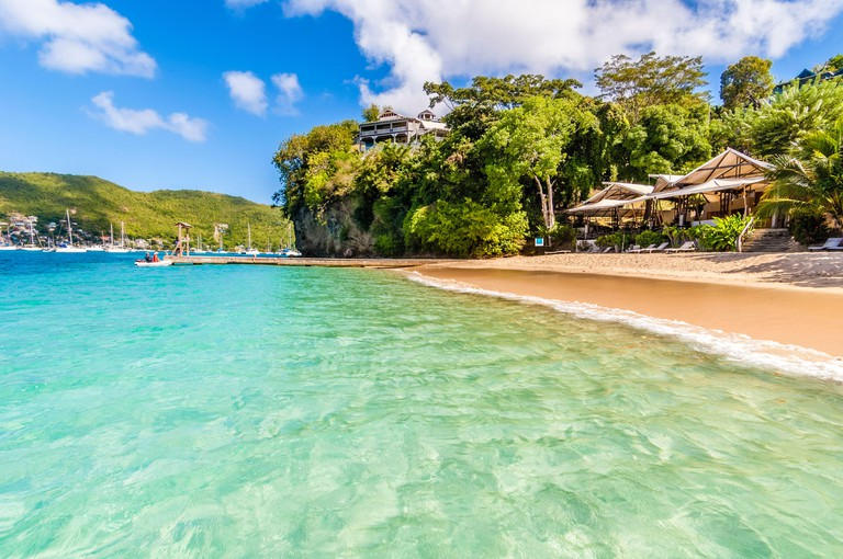 Caribbean, Lesser Antilles, St. Vincent and the Grenadines, Bequia Island, Port Elizabeth, Princess Margaret Bay, Jack's Beach Bar on the red sandy beach