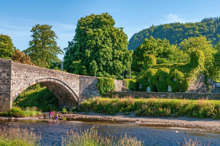 Llanrwst's Virginia Creeper-covered tea room on the River Conwy, North Wales.
