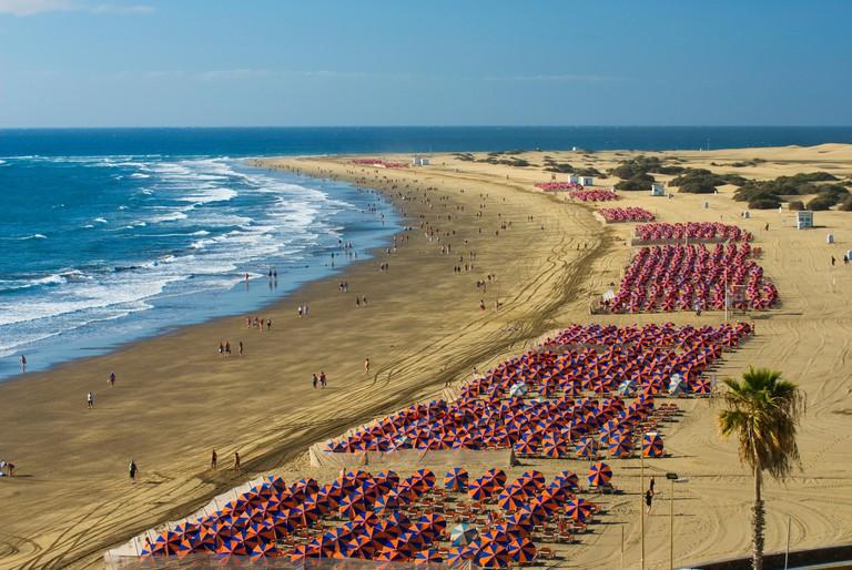 View along beach of Playa del Ingles to the Maspalomas sand dunes