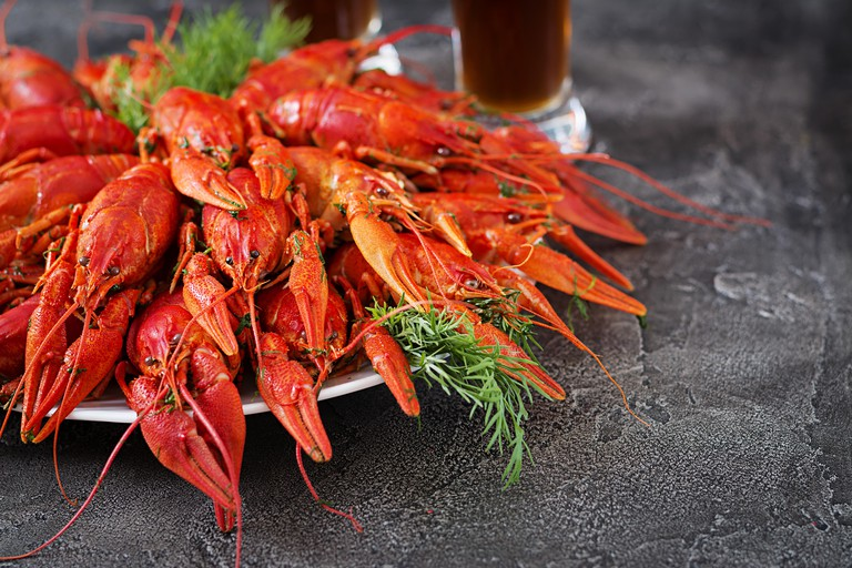 Crayfish. Red boiled crawfishes on table in rustic style