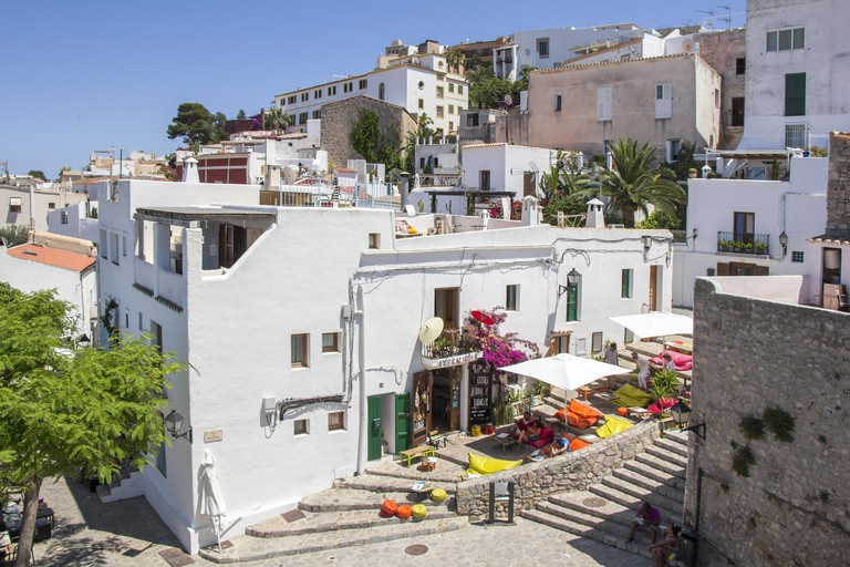 IBIZA, SPAIN - JUNE 21, 2017. View of the Ibiza old town streets in Dalt Vila plenty of restaurants. IBIZA is one of the Balearic islands that are loc