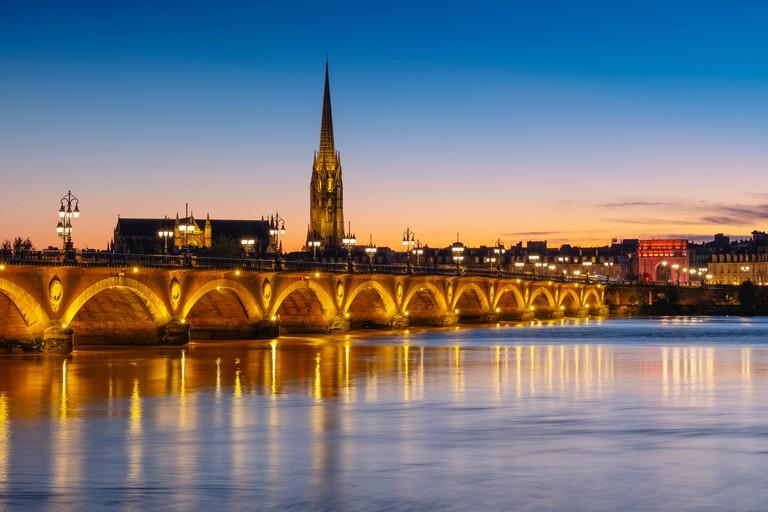 Pont de Pierre at dusk. Stone Bridge & Garonne River. Bordeaux, Gironde. Aquitaine region. France Europe
