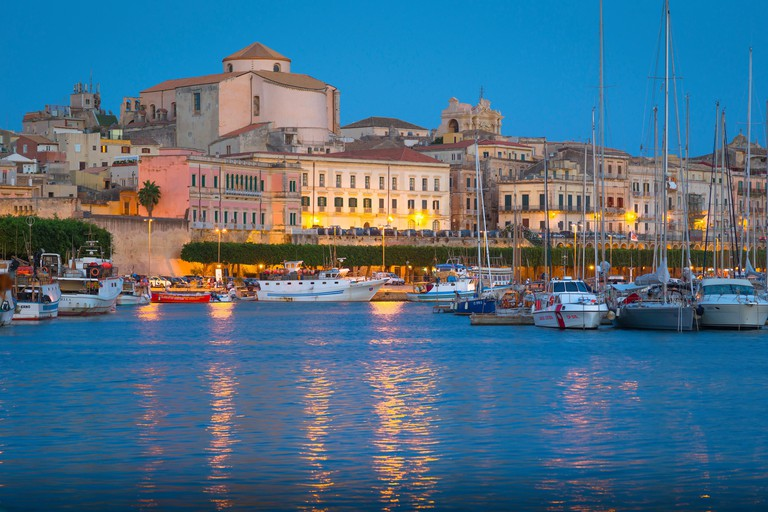 Syracuse Sicily Italy, summer evening view of the historic harbour in Ortigia, Syracuse (Siracusa), Sicily.