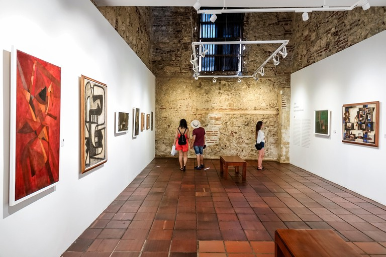 Colombia, Cartagena, Old Walled City Center centre, Centro, Museo de Arte Moderno, modern art museum gallery, exhibit, inside interior, paintings, adu