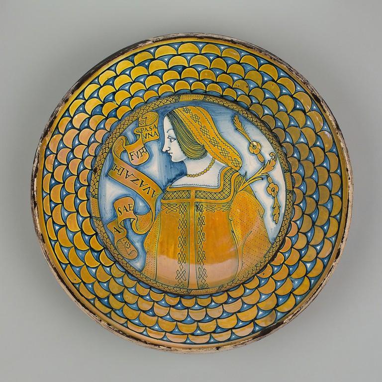 Display Plate with Female Bust. Italian, Deruta. Date: 1515-1525. Dimensions: Diameter: 40.6 cm (16 in.), H: 8.9 cm (3 1/2 in.). Tin-glazed earthenware with copper luster. Origin: Deruta. Museum: The Chicago Art Institute. Author: Italy) Societa anonima c