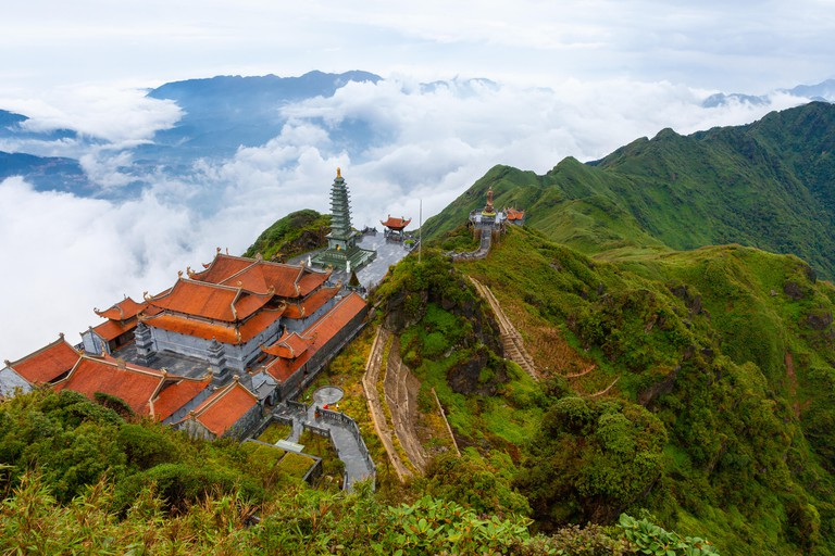 Stunning view of mountains and the temple from the summit of the Fansipan Mountain, Sapa, Lao Cai, Vietnam