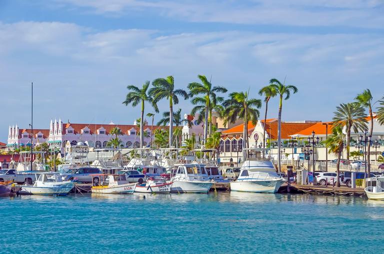 Renaissance Marina Oranjestad Aruba with fleet of fishing boats next to LG Smith Blvd.