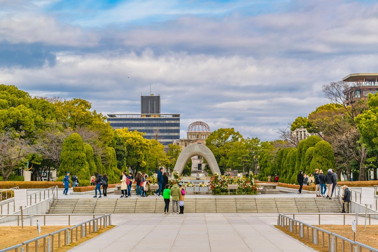 HIROSHIMA, JAPAN, 2019 - Tourists visit the peace park memorial at hiroshima city, japan
