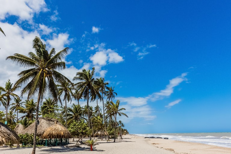 woman sunbathing Palomino beach at La Guajira in Colombia South America