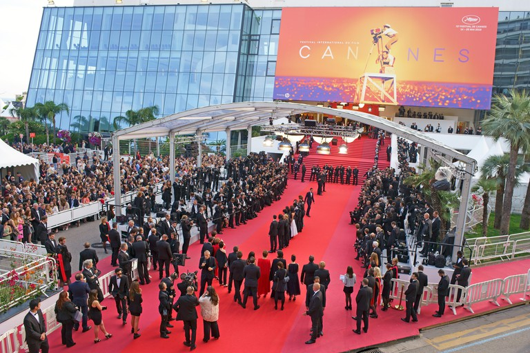 ACTORS POSING FOR PHOTOGRAPHERS ON THE RED CARPET BEFORE GOING UP THE FAMOUS 24 STEPS (aerial view from a 6-meter mast). Cannes Film Festival, France.
