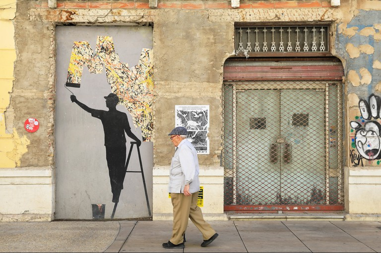 Street art by Pejac covers a derelict building in Soho or the Art District, in Malaga city, on the Costa del Sol, in Spain, Europe