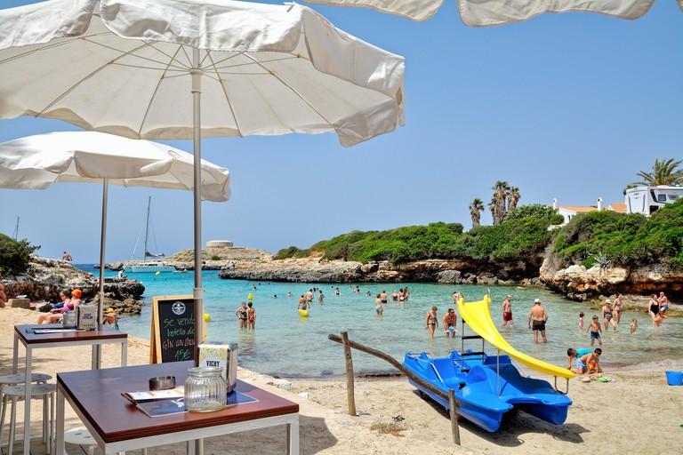 W3MH4E The beach and cove at Sa Caleta on a hot summers day,Cala Santandria Ciutadella Menorca Balearic Islands Spain Europe