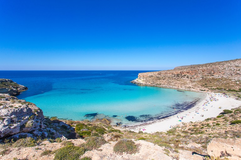 Lampedusa Island Sicily - Rabbit Beach and Rabbit Island  Lampedusa ?Spiaggia dei Conigli? with turquoise water and white sand at paradise beach.