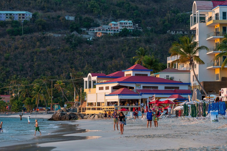 West Indies, British Virgin Islands, Tortola Island, on Cane Garden Bay's last end-of-day bathing beach, in the background the famous Quitos bar