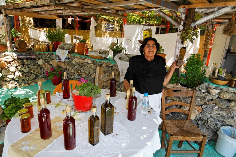 Greek woman, sells local products, such as olive oil, Zakynthos island, Greece