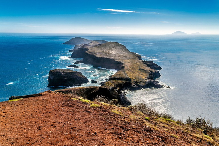 Levada walking trail with view of the Sao Lourenco peninsula in Madeira, Portugal