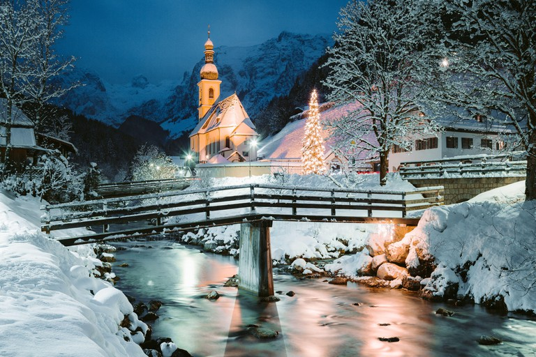 Beautiful twilight view of Sankt Sebastian pilgrimage church with decorated Christmas tree illuminated during blue hour at dusk in winter, Ramsau, Nat