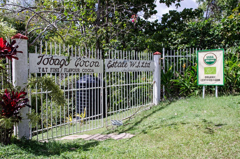 Roxborough, Trinidad and Tobago - January 10, 2020: Gates at the entrance to the Tobago Cocoa Estate which produces organic cocoa beans for the chocol