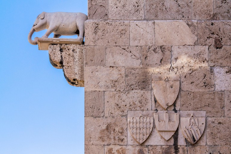 Elephant tower, detail of the exterior of the Torre dell'Elefante in the Castello, showing the stone statue of an elephant, Cagliari, Sardinia, Italy