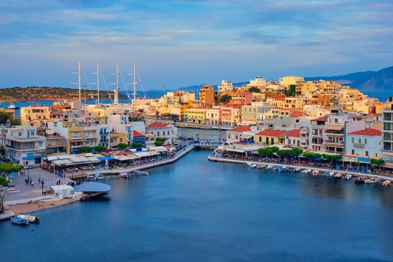 Beautiful Agios Nikolaos town on lake Voulismeni on sunset. island Crete, Greece