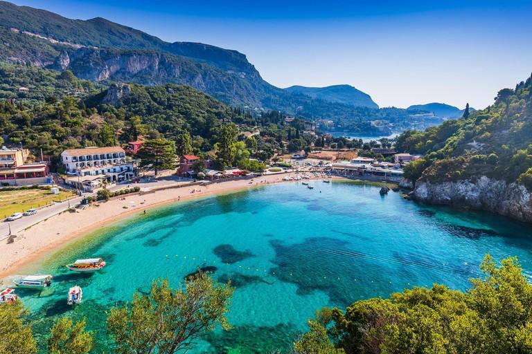 Corfu, Greece. Picturesque village of Paleokastritsa and its beach.