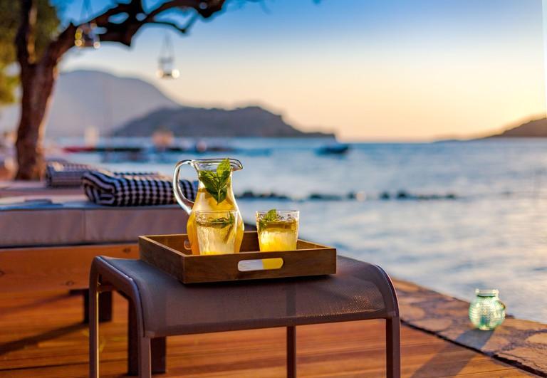 Lemonade on the beach by the sea, Crete, Greece.