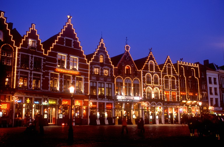 Bruges - Christmas illuminations and decorations on restaurants in Grote Market