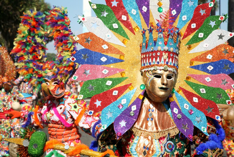 Carnival participants from Santiago dressed up as Diablo Cojuelo performing during Santo Domingo Carnival, Dominican Republic