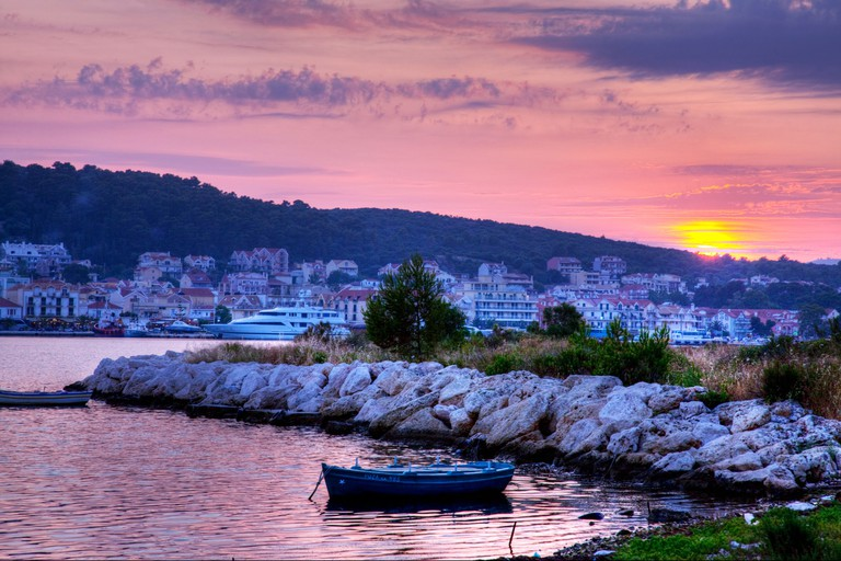 Sunset falls on Argostoli in Kefalonia, Greek Island, tropical view over the harbour, ships, boats & plam trees. Image shot 06/2009. Exact date unknown.