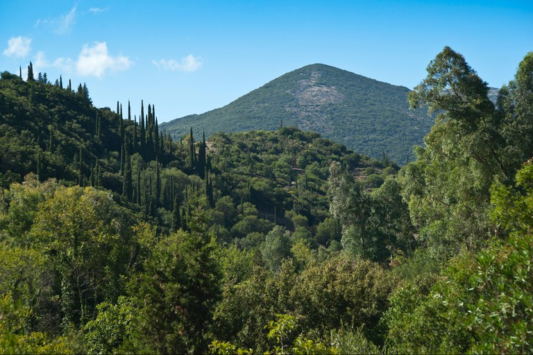 Green Kefalonia island landscape in the mountains at Ayios Nikolaos, Pirgi district, with Mount Ainos in distance