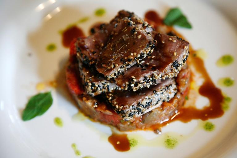 Tuna dish at The upmarket Luigi Pomata restaurant, Cagliari, Sardinia, Italy.