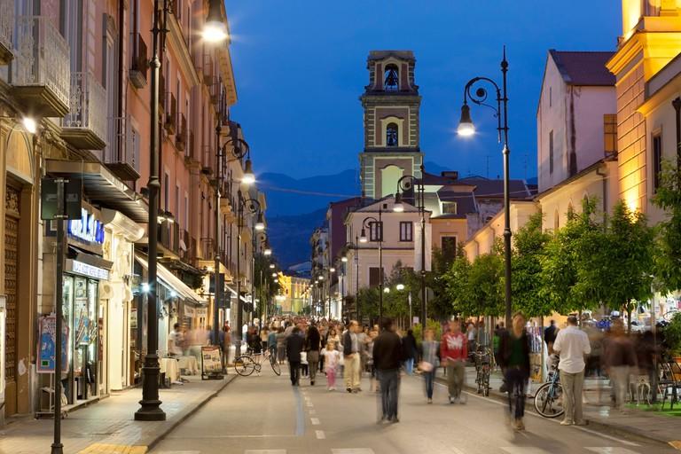 Evening passeggiata along the Corso Italia with the Campanile de la Cattedrale